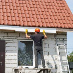 man fixing the gutter